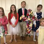 Kids and their flowered cross